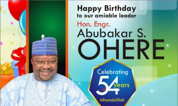 HON. LAWAL FELICITATES WITH ENGR, OHERE ON HIS BIRTHDAY